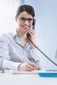 Woman answering phone calls — Stock Photo