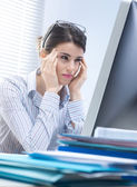 Tired businesswoman with headache — Stock Photo