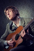 Vintage guy playing acoustic guitar — Stock Photo