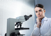 Female researcher working with microscope — Stock Photo