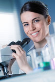 Female researcher smiling — Stock Photo