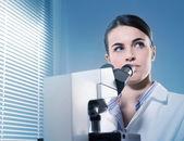 Female researcher thinking — Stock Photo