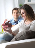 Woman receiving gift box from boyfriend — Stock Photo