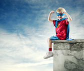 Super hero boy with raised fists — Stock Photo