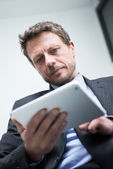 Businessman working with tablet — Stock Photo