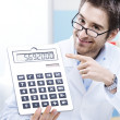 Doctor and calculator — Stock Photo #47519525