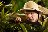 Confident adventurer exploring the rainforest jungle — Stock Photo