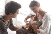 Couple  Learning the guitar — Stock Photo