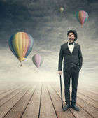 Imaginative vintage businessman with hot air ballons — Stock Photo