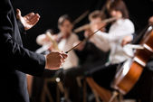 Orchestra conductor on stage — Stock Photo
