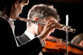 Symphony orchestra performance: flutist close-up — Stock Photo