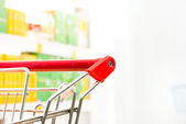 Supermarket trolley at store — Stock Photo