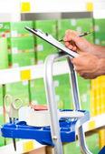 Supermarket clerk at work — Stock Photo