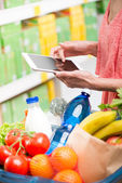 Shopping with tablet — Foto Stock