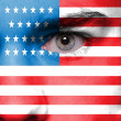 Stock Photo: Human face painted with flag of USA