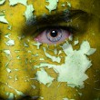 Cracked paint on face — Stock Photo