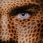 Lizard skin pattern on man face — Stock Photo