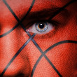 Basketball pattern on angry man face — Stock Photo #28548887