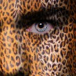 Leopard pattern on face — Stock Photo