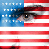 Human face painted with flag of USA — Stock Photo