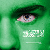 Saudi Arabia flag painted on face — Stock Photo