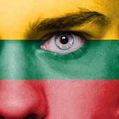 Lithuania flag painted on face — Stock Photo