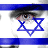 Israel flag painted on face — Stock Photo