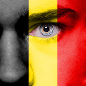 Belgium flag painted on face — Stock Photo