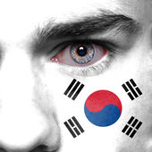 Korea flag on man face — Stock Photo