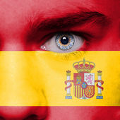 Painted face with flag of Spain — Stock Photo