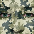 Woodland camouflage painted on woman a face — Stock Photo