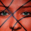 Basketball pattern on woman face — Stock Photo