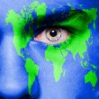 World map over angry man face — Stock Photo