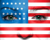USA flag painted on woman face — ストック写真