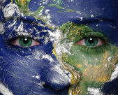 Earth painted on face. Elements of this image furnished by NASA — Stock Photo