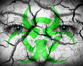 Biohazard symbol painted on face — Stock Photo