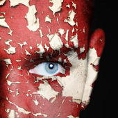Cracked paint on man face — Stock fotografie