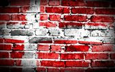 Denmark flag on old brick wall Background or texture — Stock Photo