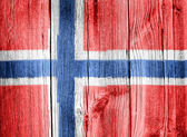 The Norwegian flag painted on wooden fence — Stock Photo