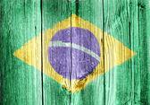 Flaga brazylii na starej drewnianej ścianie — Zdjęcie stockowe