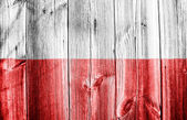 Polish flag painted on wooden fence — Stock Photo