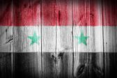 The Syria flag painted on wooden fence — Stock Photo