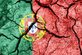 Cracked soil as Portugal flag — Stock Photo