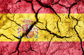 Spain flag on cracked earth background — Stock Photo