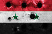 Syria flag grunged with bullet holes — Stock Photo