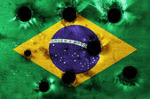 Grunge flag of Brazil with bullet holes — Stockfoto