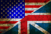 Usa and England flag together on grunge background — Stockfoto