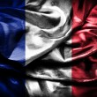 Dark France flag on satin texture — Stock Photo
