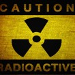 Radioactive symbol on old grunge background — Stock Photo