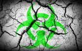 Biohazard sign on cracked earth texture — Stock Photo